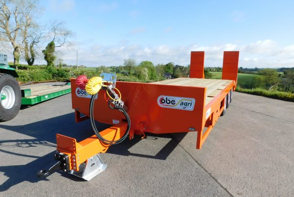 Orange low loader trailer